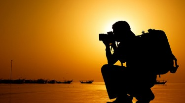 Picture titled Shooter by Jhong Dizon. A photographer's silhouette with the sunset in the back.